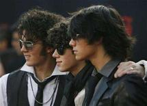<p>The Jonas Brothers arrive at the 2007 American Music Awards in Los Angeles, November 18, 2007. Concert touring company Live Nation on Thursday said it reached a two-year, multimillion dollar, worldwide touring deal with tween rockers Jonas Brothers. REUTERS/Mario Anzuoni</p>