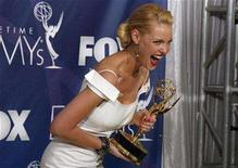 """<p>File photo shows Katherine Heigl reacting backstage as she holds her award for outstanding supporting actress in a drama series for her role in """"Grey's Anatomy"""" at the 59th Primetime Emmy Awards in Los Angeles, California, Sept. 16, 2007. Fox will delay the release of """"27 Dresses"""" until Jan. 18, the first day of the Martin Luther King Jr. holiday weekend, citing an overwhelming response to sneak previews for Heigl's romantic comedy. REUTERS/Lucy Nicholson</p>"""