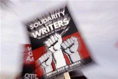 <p>File photo shows a picket sign from the Writers Guild of America is seen as members protest in front of NBC studios in Burbank, California, Jan. 2, 2008. REUTERS/Phil McCarten</p>