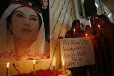 <p>Christians hold a placard next to a picture of slain opposition leader Benazir Bhutto outside a church in Multan, Pakistan, January 6, 2008. HarperCollins will rush out a book submitted by former Pakistani Prime Minister Benazir Bhutto just days before her December 27 assassination, it said on Monday. REUTERS/Asim Tanveer</p>