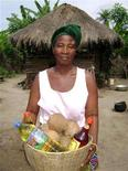<p>Ayayi Kayi, 52, of Aneho, Togo, a married and caretaker for six people is seen in this undated handout photo. Her principle economic activity is the production of coconut oil which she then sells. REUTERS/kiva.org/Handout</p>
