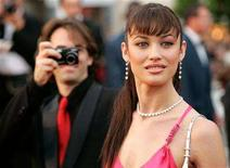 """<p>Actress Olga Kurylenko arrives for the screening of 'Paris Je T'aime' which opens the 'Un Certain Regard' competition at the 59th Cannes Film Festival May 18, 2006. In the secretive world of movie spy James Bond, the """"Bond girl"""" for the new installment in the movie series had been top secret, but on Monday Bond's backers said Ukrainian bombshell Olga Kurylenko is the actress. REUTERS/Mario Anzuoni</p>"""
