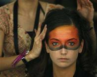 <p>A model has her hair adjusted backstage before the Shu Uemura show during the Singapore Fashion Festival March 26, 2007. Uemura, a beautician who parlayed success as a Hollywood make-up artist into an international cosmetics brand under his name, has died aged 79. REUTERS/Vivek Prakash</p>