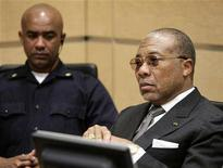 <p>Former Liberian President Charles Taylor sits in the courtroom of the International Criminal Court prior to the hearing of witnesses in his trial in The Hague January 7, 2008. REUTERS/Michael Kooren</p>