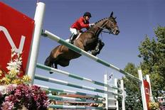 <p>Canada's Eric Lamaze and his horse Hickstead jump a set of rails during the CN International show jumping competition at the Spruce Meadows Masters in Calgary, Alberta, in this September 9, 2007 file photo. It seems the Montreal native is peaking at the right time for inclusion in the team. He amassed more than $1 million in prize money last year, some $600,000 of which was with Hickstead, his targeted Olympic partner. His recent successes have prompted many to suggest Lamaze could put the Canadian team in a competitive position in Beijing in August, as well as possibly take a medal in the individual events. REUTERS/Todd Korol/Files</p>