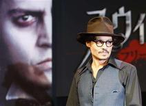 """<p>Johnny Depp enters a news conference to promote his latest film """"Sweeney Todd: The Demon Barber of Fleet Street"""", in Tokyo January 9, 2008. REUTERS/Toru Hanai</p>"""