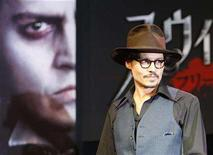 """<p>Johnny Depp enters a news conference to promote his latest film """"Sweeney Todd: The Demon Barber of Fleet Street"""", in Tokyo January 9, 2008. In Sweeney Todd, Depp compares the flavors of different types of human flesh. But the actor says his own would taste of frogs' legs. REUTERS/Toru Hanai</p>"""