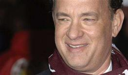 """<p>U.S. actor Tom Hanks poses for photographers at the premiere of """"Charlie Wilson's War"""" in London January 9, 2008. REUTERS/Anthony Harvey</p>"""