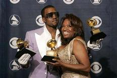 """<p>Rap singer Kanye West (L) poses with his mother Donda West at the 48th annual Grammy Awards in Los Angeles February 8, 2006. The Los Angeles County Coroner said on Thursday the exact cause of Donda West's death in November was unclear but there was no sign of """"surgical or anesthetic misadventure."""" REUTERS/Robert Galbraith</p>"""