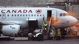 <p>Paramedics come out of an Air Canada plane after 10 passengers were injured when the plane hit air turbulence over the Rocky Mountains enroute to Toronto from Victoria, at Calgary International Airport in Calgary January 10, 2008. REUTERS/Todd Korol</p>