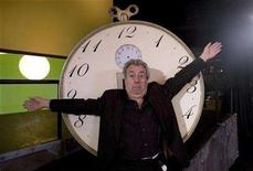 "<p>Former Monty Python star Terry Jones gestures in front of a ""time machine"" before an interview with Reuters in Lisbon January 10, 2008. REUTERS/Nacho Doce</p>"