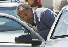 <p>Former NFL football star O.J. Simpson ducks into a car outside the Clark County Detention Center in Las Vegas, Nevada September 19, 2007. Simpson was taken into custody in Florida on Friday after prosecutors asked a judge to revoke his bail and return him to jail while he awaits armed robbery and other charges. REUTERS/Rick Wilking</p>
