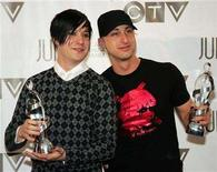 """<p>Members of the band Simple Plan pose with their statuettes after winning the Fans Choice award at the Juno awards in Halifax, Canada April 2, 2006. For Simple Plan, the multimillion-selling pop-punk band from Montreal, """"The End"""" was also a new beginning.REUTERS/Paul Darrow</p>"""