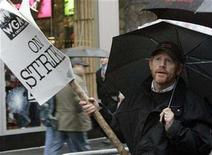<p>Director Ron Howard walks the picket line with members of the Writers Guild of America in New York's Times Square, November 15, 2007. With rumors flying of an imminent deal, it's safe to say that Day 3 of the Directors Guild of America's contract talks with the studios went well enough for another session to be scheduled for Tuesday. REUTERS/Brendan McDermid</p>
