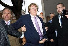 <p>Chief Executive Officer of Terra Firma, Guy Hands (C), arrives for a meeting in London, January 15, 2008. British music company EMI, which is owned by Terra Firma, is to axe up to 2,000 jobs in a restructuring plan by its new private-equity owners to save up to $392 million a year and recast itself for the digital age. REUTERS/Kieran Doherty</p>