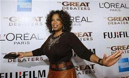 """<p>Oprah Winfrey arrives at the premiere of """"The Great Debaters"""" at the Arclight Cinerama Dome in Hollywood, California December 11, 2007. Winfrey is adding a cable network to her media empire through a deal with Discovery Communications. REUTERS/Mario Anzuoni</p>"""