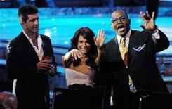 """<p>""""American Idol"""" judges Simon Cowell (L), Paula Abdul (C) and Randy Jackson wave to the crowd during the show's finale at the Kodak Theater in Hollywood, May 24, 2006. Coca-Cola, Ford and AT&T are back again as the three main sponsors of """"American Idol,"""" which returned to the airwaves on Tuesday. REUTERS/Chris Pizzello</p>"""