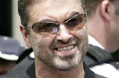 """<p>George Michael reads a statement to the media as he leaves Brent Magistrates Court in London June 8, 2007. Michael will write a no-holds-barred biography to appear in autumn 2009 after signing what HarperCollins called """"one of the biggest book deals ever concluded in UK publishing."""" REUTERS/James Boardman</p>"""