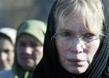 "<p>A tear goes down the face of Hollywood actress and UNICEF ambassador Mia Farrow (L) as she visits the cemetery where victims of 1995 massacre of up to 8,000 Muslim men and boys are buried in Srebrenica December 6, 2007. Cambodia has barred Farrow and a group campaigning for an end to atrocities in Sudan's Darfur region from lighting a symbolic Olympic torch at a ""Killing Fields"" memorial site. REUTERS/Danilo Krstanovic</p>"