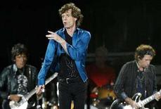"""<p>Rolling Stones lead singer Mick Jagger (C), guitarist Keith Richards (R), drummer Charlie Watt (2nd R) and Ron Wood (L) perform during the band's """"A Bigger Bang"""" European tour stop in Lausanne August 11, 2007. The Rolling Stones has signed an exclusive worldwide recording agreement to release its next album through Universal Music Group, prompting speculation that it could leave EMI. REUTERS/Denis Balibouse</p>"""