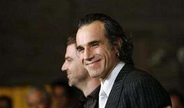 """<p>British actor Daniel Day-Lewis (R) smiles next to director Paul Thomas Anderson at the 33rd annual Los Angeles Film Critics Association Awards in Los Angeles January 12, 2008. Day-Lewis and Anderson received the awards respectively as best actor and best director for """"There Will Be Blood"""". REUTERS/Mario Anzuoni</p>"""