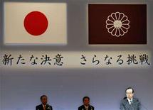 "<p>Japanese Prime Minister Yasuo Fukuda (R), who is also the head of Japan's ruling Liberal Democratic Party, delivers a speech at the party annual convention in Tokyo January 17, 2008. The Japanese national flag (top L), his party flag (top R) and slogans reading ""Fresh Resolve, Further Challenge"" are seen behind him. REUTERS/Issei Kato</p>"