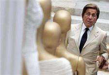 """<p>Veteran Italian fashion designer Valentino Garavani poses during the opening of his exhibition at the Ara Pacis Museum in Rome July 6, 2007. The life of fashion designer Valentino is coming to the big screen in the documentary """"Valentino: The Last Emperor."""" REUTERS/Alessandro Bianchi</p>"""