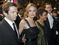 """<p>Cast members Dan Futterman and Angelina Jolie, Mariane Pearl and producer Brad Pitt (L-R) depart after a gala screening of British director Michael Winterbottom's film """"A Mighty Heart"""" at the 60th Cannes Film Festival May 21, 2007. This year, a number of actresses have taken on the challenge of playing real-life people -- from Jolie as Pearl, Marion Cotillard as Edith Piaf in """"La Vie en Rose"""" to Cate Blanchett as Elizabeth I in """"Elizabeth: The Golden Age. REUTERS/Jean-Paul Pelissier</p>"""