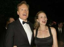 """<p>Conan O'Brien and wife Liza Powel attend the Governor's Ball after the 58th annual Primetime Emmy Awards at the Shrine Auditorium in Los Angeles August 27, 2006. O'Brien has bought a Los Angeles home valued at just under $10.5 million in preparation for his move from New York to take over the reins of NBC's """"The Tonight Show,"""" the Los Angeles Times reported on Saturday. REUTERS/Fred Prouser</p>"""