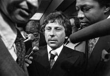 """<p>Film director Roman Polanksi is shown surrounded by press in Los Angeles in this undated photograph released January 19, 2008. Polanski is the subject of the documentary film """"Roman Polanski: Wanted and Desired"""" by director Marina Zenovich, which is in competition at the 2008 Sundance Film Festival in Park City, Utah. The film tells the untold story of the scandal that caused the Polish–born director to flee America. REUTERS/LOS ANGELES TIMES/UCLA Library Department of Special Collections/Sundance Film Festival/Handout</p>"""