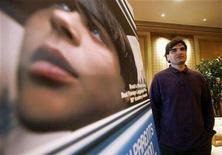 """<p>Cao Hamburger, Brazilian director of the movie """"The Year My Parents Went on Vacation,"""" poses next to the movie's poster in New York, December 4, 2007. REUTERS/Shannon Stapleton</p>"""