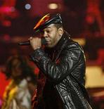 "<p>In this file photo singer Busta Rhymes performs ""Shaft"" during the taping of ""Movies Rock"" at the Kodak theatre in Hollywood, California, December 2, 2007. The Grammy-nominated rapper pleaded guilty on Wednesday to assault, two driving infractions and weapons possession, avoiding a trial and the yearlong prison sentence recommended by prosecutors. REUTERS/Mario Anzuoni</p>"