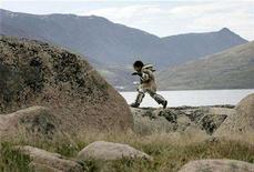 <p>An Inuit girl dressed in traditional clothing plays on rocks in Pangnirtung, Nunavut July 5, 2007. The Inuit in Canada's far north have lifespans 12 to 15 years shorter than the average Canadian's, government data showed on Wednesday, putting the aboriginal people on a par with developing countries such as Guatemala and Mongolia. REUTERS/Chris Wattie</p>