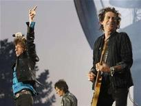 """<p>Rolling Stones lead singer Mick Jagger (L), guitarist Keith Richards (R) and Ron Wood (C) perform during the band's """"A Bigger Bang"""" European tour stop in Lausanne August 11, 2007. Film director Dieter Kosslick snatched Martin Scorsese's eagerly awaited documentary about the Rolling Stones away from rival film festivals. REUTERS/Denis Balibouse</p>"""
