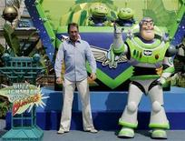 """<p>Actor Tim Allen and character Buzz Lightyear prepare to open the Buzz Lightyear Astro Blasters attraction in Disneyland May 4, 2005. Allen was the voice talent for Buzz Lightyear in Disney-Pixar's """"Toy Story"""" and """"Toy Story 2"""" which the Walt Disney Studios plans to debut in digital 3-D. REUTERS/Fred Prouser</p>"""