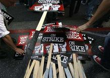 """<p>Signs are piled up at the end of a rally of striking members of the Writers Guild of America in Hollywood, November 20, 2007. Hollywood's striking writers said on Monday they will grant an """"interim agreement"""" to organizers of the Grammy awards allowing the ceremony honoring musicians to be written by union members. REUTERS/Mario Anzuoni</p>"""