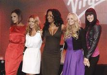 <p>British group Spice Girls (L-R) Victoria Beckham, Geri Halliwell, Mel B, Emma Bunton and Mel C pose at the launch of the new Terminal 3 at Heathrow airport, London, December 13, 2007. REUTERS/Anthony Harvey</p>
