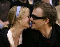 <p>Heath Ledger (R) kisses Michelle Williams during the NBA game between the San Antonio Spurs and the Los Angeles Lakers in Los Angeles March 6, 2006. In her first statement since the death of her former companion Heath Ledger, Williams asked for privacy for her and daughter Matilda and said she suffers from a broken heart. REUTERS/Lucy Nicholson</p>