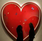 """<p>Visitors view Damien Hirst's """"All You Need Is Love"""" artwork at Sotheby's auction house in central London December 5, 2007. The contemporary art world's brightest stars have aligned to provide AIDS relief in Africa with a special auction in New York conceived by Hirst and rock star Bono. REUTERS/Alessia Pierdomenico</p>"""