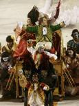 <p>Atração da Mocidade Independente de Padre Miguel, que abriu o segundo dia de desfiles do Carvaval do Rio de Janeiro. Photo by Stringer</p>