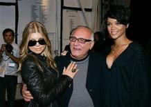 <p>Singers Fergie (L) and Rihanna (R) pose with designer Max Azria after the 2008/2009 fall collection show during New York Fashion Week February 4, 2008. For top designers like Azria, celebrity events are important, but he said his business would not be hurt by the loss of the Golden Globes or potential Oscars' cancellation. REUTERS/Carlo Allegri</p>