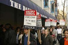 """<p>Picketers from the Writers Guild Of America demonstrate in front of the studio where """"The Daily Show"""" is filmed in New York, January 7, 2008. REUTERS/Lucas Jackson</p>"""