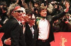 <p>Director Martin Scorsese (C) poses with Rolling Stones members Keith Richards, Charlie Watts, Ron Wood and Mick Jagger at the red carpet as they arrive for the screening of the opening film 'Shine A Light' running in competition at the 58th Berlinale International Film Festival in Berlin February 7, 2008. REUTERS/Johannes Eisele</p>