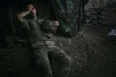"""<p>Tim Hetherington, a Vanity Fair photographer based in Britain, won the World Press Photo of the Year 2007 award with this picture of an American soldier resting at a bunker in Korengal Valley, Afghanistan taken September 16, 2007. Jury chairman of the World Press Photo 2007 contest, Gary Knight, said """"This image shows the exhaustion of a man and the exhaustion of a nation, we're all connected to this. It's a picture of a man at the end of a line"""". The prize-winning entries of the World Press Photo Contest 2008, the world's largest annual press photography contest, were announced February 8, 2008. REUTERS/Tim Hetherington/Vanity Fair</p>"""