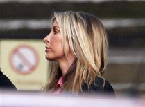 <p>Heather Mills arrives at the High Court in London February 11, 2008. Paul McCartney and former model Heather Mills lock horns in a British divorce court on Monday in their battle over how how big a slice she will take of the former Beatle's fortune. REUTERS/Stephen Hird</p>