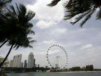 <p>A maior roda gigante do mundo, a Singapore Flyer, realizou sua primeira volta nesta segunda-feira, oferecendo a passageiros uma ampla visão panorâmica da cidade-Estado, assim como de partes das vizinhas Malásia e Indonésia. Photo by Pablo Sanchez</p>