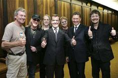 <p>Russia's First Deputy Prime Minister and presidential candidate Dmitry Medvedev (C), who is also chairman of Gazprom, and Gazprom Chief Executive Officer Alexei Miller (2nd R) pose for a picture with English hard rock band Deep Purple after a ceremony marking Gazprom's 15th anniversary in Moscow February 11, 2008. REUTERS/Dmitry Astakhov/RIA Novosti</p>