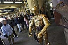 """<p>A person dressed as a character from the movie Star Wars greets people on the sidewalk outside the Penn Plaza Pavilion in New York November 17, 2007. """"Star Wars: The Clone Wars"""" will open in theaters on August 15, ahead of a series of 30-minute """"mini-movies"""" that will premiere on the Cartoon Network and TNT cable channels in the fall. REUTERS/Jacob Silberberg</p>"""