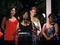 "<p>Writer for the television series ""Grey's Anatomy"" Shonda Rhimes (2nd L) accepts the ""Lucy Award"", as cast members Sara Ramirez (L), Kate Walsh and Chandra Wilson (R) stand nearby, at the Women in Film 2007 Crystal and Lucy Awards in Beverly Hills, California June 14, 2007. A day before Writers Guild of America members vote on whether to end their three-month strike, the broadcast networks on Monday began firming up their production plans. REUTERS/Mario Anzuoni</p>"