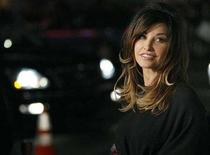 """<p>Gina Gershon poses at the premiere of """"P.S. I Love You"""" at the Grauman's Chinese theatre in Hollywood, California December 9, 2007. REUTERS/Mario Anzuoni</p>"""